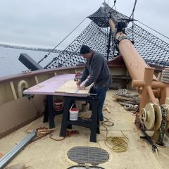 Cutting plywood on the foredeck